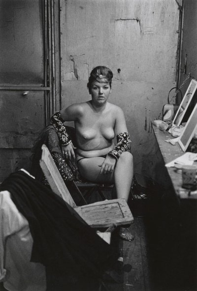 Diane Arbus, Stripper with bare breasts sitting in her dressing room, Atlantic City, N.J © The Estate of Diane Arbus, LLC. All rights reserved.
